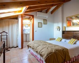 Nuestras habitaciones abuhardilladas. Unas habitaciones para que tu estancia sea una experiencia bajo ese techo de madera